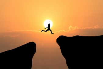 courage-man-jump-through-the-gap-between-hill-business-concept-idea_1323-262